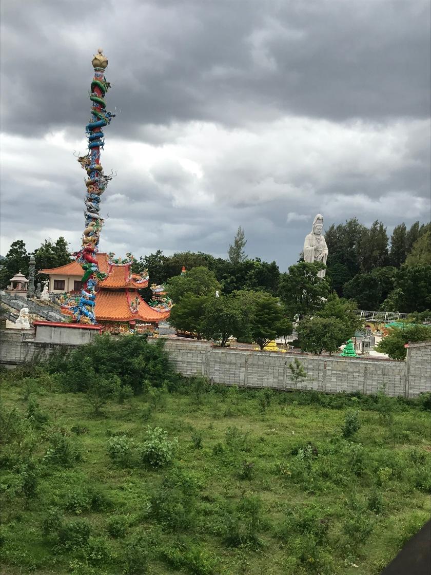 Dragons next to Buddha Statue