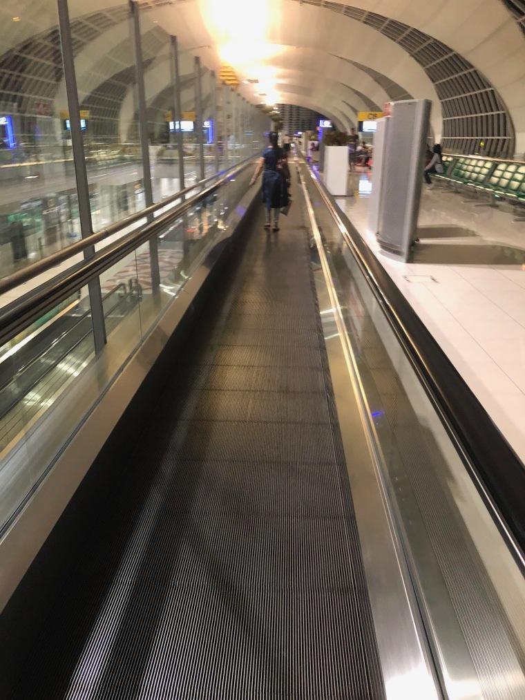Walk Along Escalator on the Departure Gate