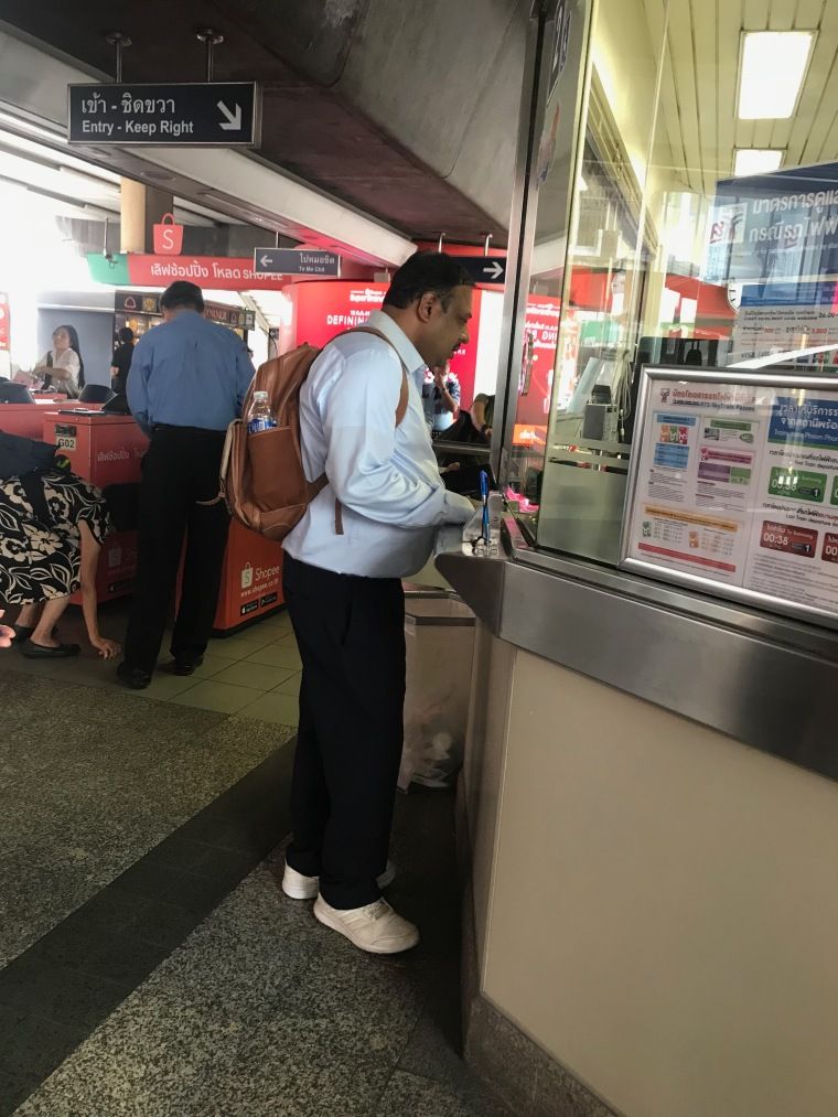 Buying ticket from Ticket Counter